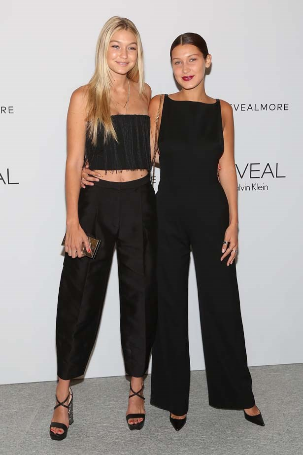Posing with her older sister Gigi, Bella stuns in this black jumpsuit.