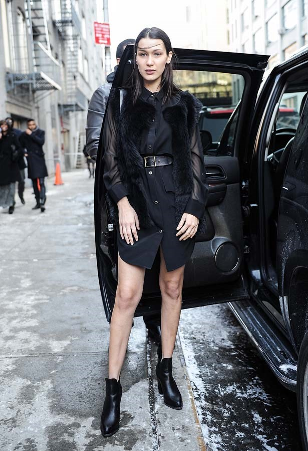 Bella strikes a pose before entering her ride at NYFW.