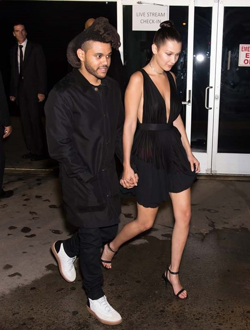 Bella wears a low-cut dress to date night with her boyfriend, The Weeknd.