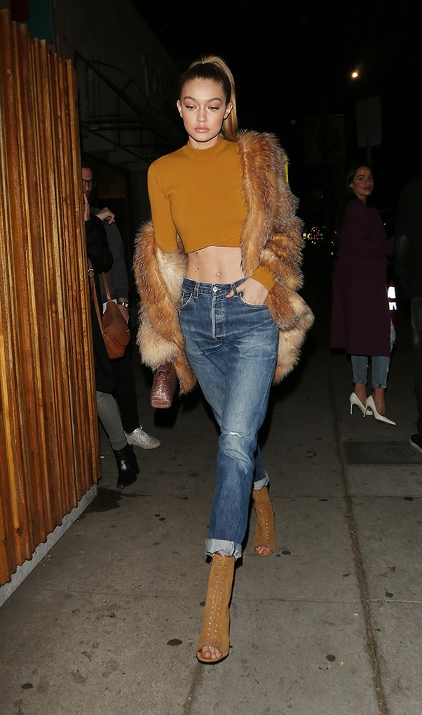 Caramel crop sweater? Check. Casual fur throw? Check. Glossy high pony? Check, check, check.