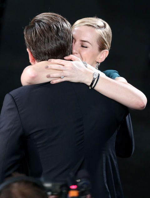 Locked in a tight embrace, after Leo's win was announced.