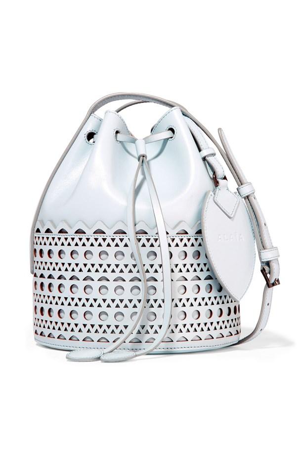 "Alaïa <a href=""https://www.net-a-porter.com/au/en/product/650872/alaia/vienne-laser-cut-leather-bucket-bag"">'Vienne' laser-cut leather bucket bag</a>, $2,481."
