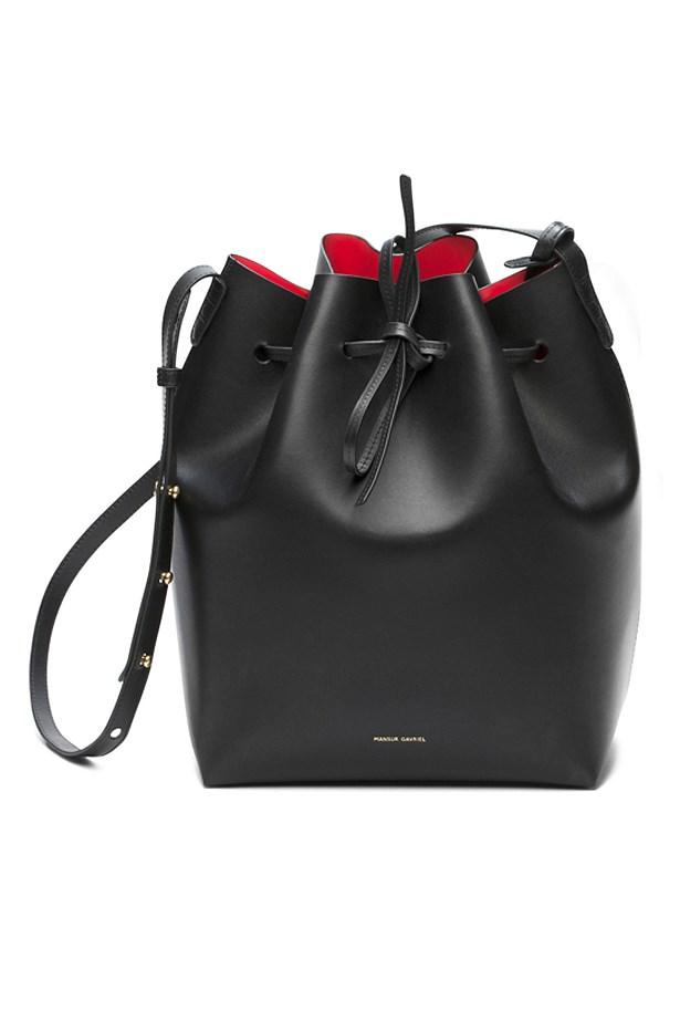 "Mansur Gavriel <a href=""http://www.mansurgavriel.com/products/bucket-bag-black/flamma"">Bucket Bag in black</a>, $595."