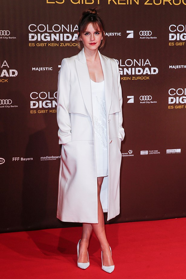 Emma debuted her new bangs with an all-white look at the Berlin premiere of her new film 'Colonia'.