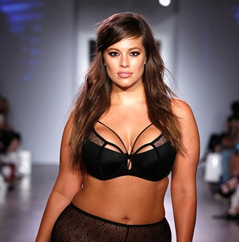 Ashley Graham walks the Addition Elle runway in lingerie.