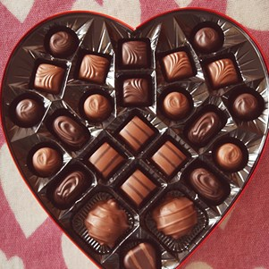 Chocolates in a heart shaped box for Valentine's Day.