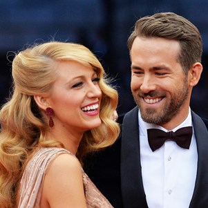Blake Lively and Ryan Reynolds on the red carpet of the MET Gala 2014.