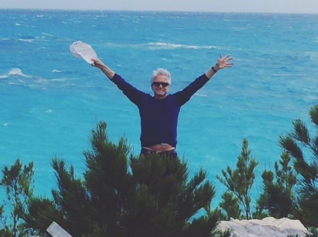 """Catherine Zeta-Jones posted this cute snap of her husband Michael Douglas on holiday, """"Happy to see me or the Bermudian bay?!!!! Don't know!!!! But love him all the same. Happy Valentine's Day Michael!!!!"""""""