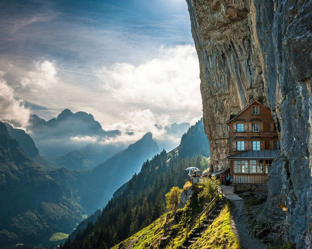 Aescher Cliff Hotel, Switzerland: You have to take a cable car ride up the mountain, and then hike another 15 minutes on foot, just to reach this cliff-side property (and the accommodation is pretty modest)… but we reckon it's worth it.