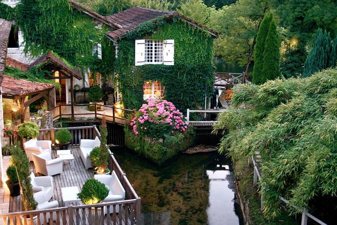 Moulin du Roc, France: This quaint hotel is housed within a converted 17th century mill and features the prettiest terrace you'll ever see in your whole life.