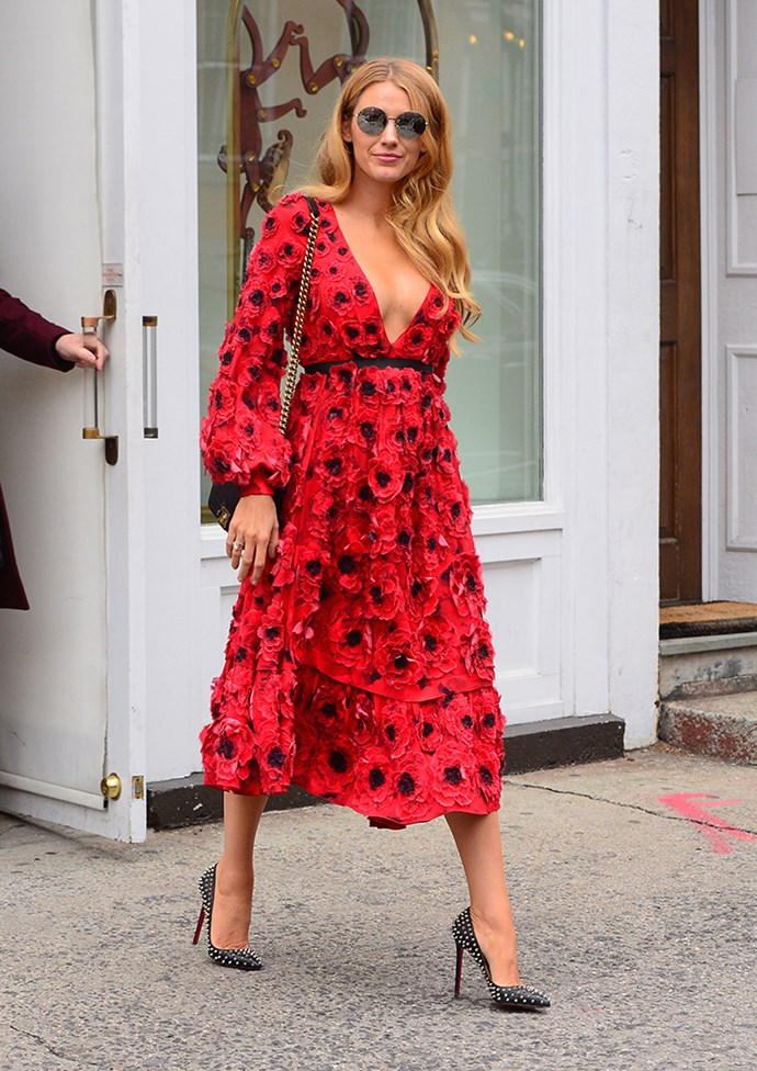 Now that's a summer dress! Blake stepped out in New York wearing a red poppy dress with bell sleeves, unexpected stud heels and a sweet pair of sunglasses.