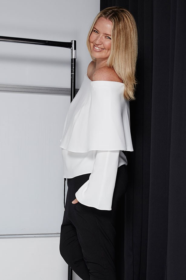 "AMY STARR, BEAUTY AND LIFESTYLE ASSOCIATE <p> <p> Trend: Off-the-shoulder<p> <p> ""I'm partial to off-the-shoulder shapes because I always feel feminine in them, but I've only ever worn them in a really boho kind of way. The minute I put this on, I loved it. It's a magical fabric that is somehow equal parts floaty and stretchy. There's enough structure to the shape so that I felt polished and work-appropriate but I didn't feel stiff and stitched-up (because, yuck). Full disclosure: off-the-shoulder cuts do restrict some movement, but remember I said it was stretchy? You probably couldn't hit the button for the penthouse in the lift, but any floor under that, you're good. Ample give for moving and grooving (always a bonus).""<p> <p> Top, $209, Cue, cue.cc"