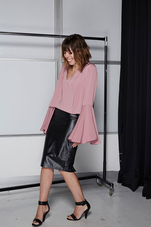 "LAURA CULBERT, DEPUTY CHIEF SUB-EDITOR<p> <p> Trend: Extreme sleeves<p> <p> ""I'm quite short and veer towards the more minimalist side of fashion, so, in all honesty, flared sleeves had me worried. But by working them back with a slim-fitting skirt and leg-lengthening heels, I didn't feel overwhelmed by the look. I also had a lot of fun waving my arms about, butterfly-style.""<p> <p> Top, $140, Keepsake, keepsakethelabel.com.au"