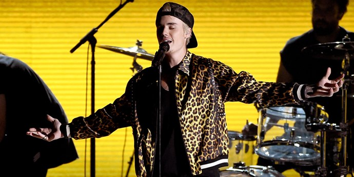 Justin Bieber singing on stage.
