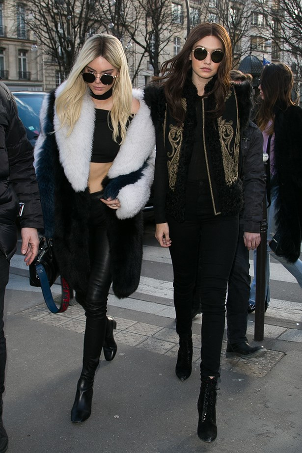 Gigi stepped out after the Balmain show in Paris with Kendall in an all-black outfit - and, of course, her iconic brunette wig.