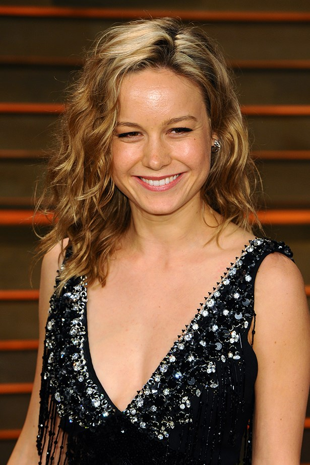 2014, Larson embraces a natural look with tousled curls and minimal makeup at the <strong>Vanity Fair Oscar Party</strong>.
