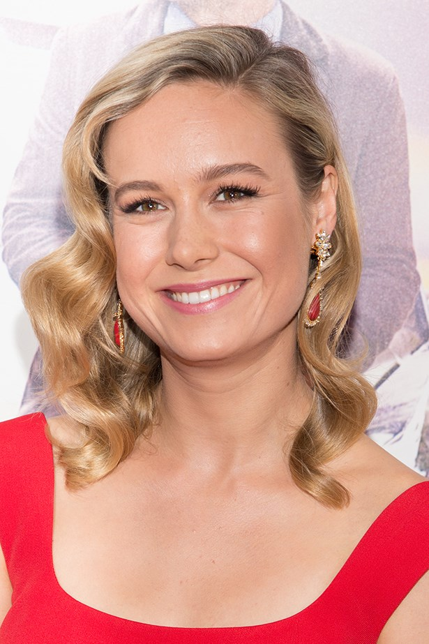 2014, Brie channels old Hollywood glamour with side swept curls and a rosy pink lip at the premiere of <strong><em>Begin Again</em></strong>.