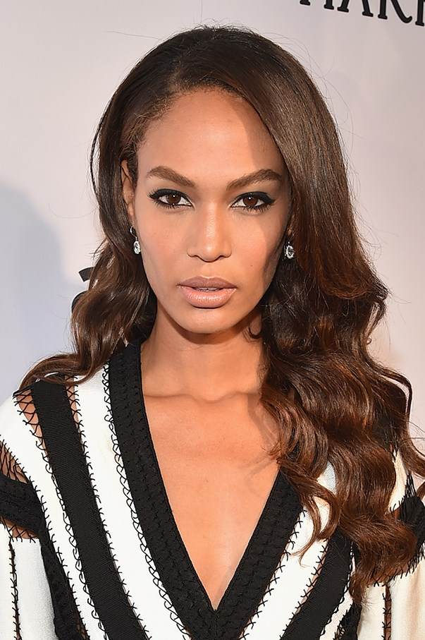 <strong>June 2015 </strong> <br><br>A signature nude lip and lined eyes gives Smalls a sultry, seductive look at the amfAR Inspiration Gala in New York.