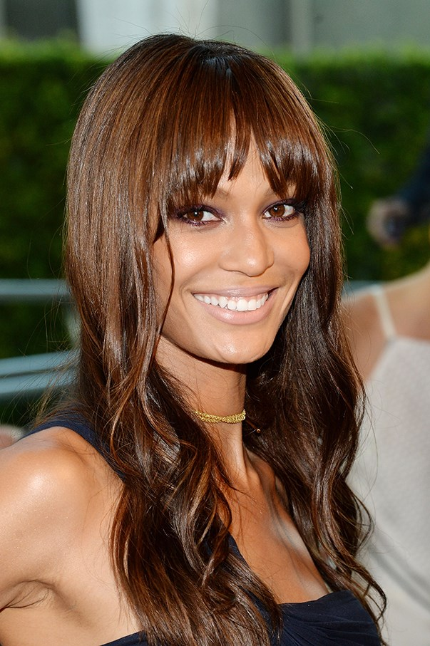 <strong>June 2014</strong> <br><br>Featuring a brief flirtation with a whispy fringe, Joan resorts to a staple ruby smoky eye and a very nude lip for the CFDA Fashion Awards.