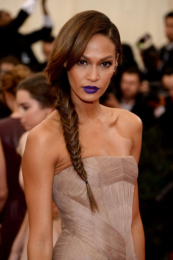 <strong>May 2014</strong> <br><br>Joan Smalls sports <em>that</em> lip colour at the 2014 Met Gala celebrating legendary designer Charles James. Smalls released the exact lip colour, amongst others, in her first collaboration with beauty giant Estee Lauder. See: Pure Color Envy Matte in Shameless Violet, $40, Estee Lauder, esteelauder.com.au