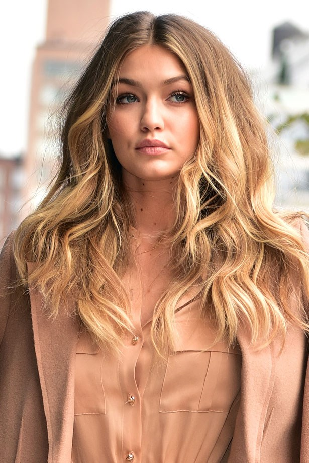 <strong>December 8, 2015</strong> <br><br> Gigi ties this monochromatic look together with a matching lip.