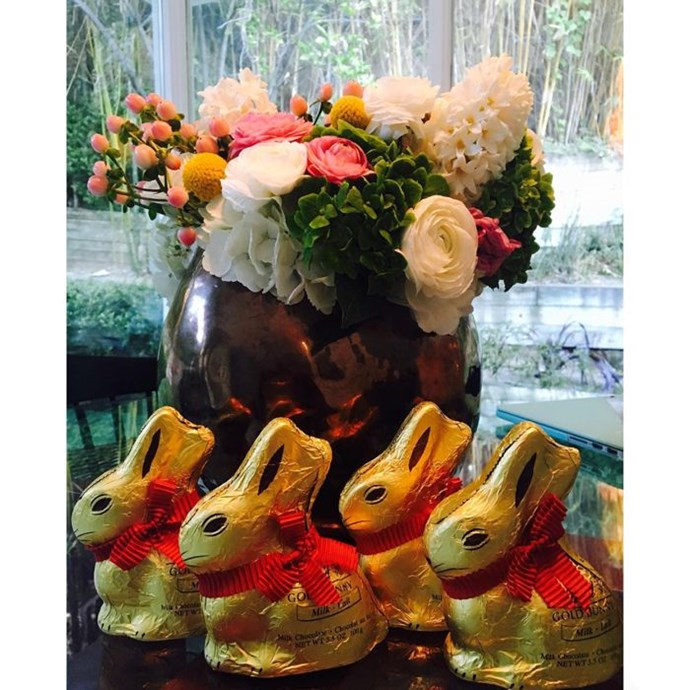 """Jaime King: """"Hop! Hop! Hop! Well, look who arrived early for baby's first Easter! Four Lindt GOLD BUNNY chocolate figures! Weird, mama's favorite;) One for mama, one for daddy, one for James Knight and one for Leo Thames! I am currently bribing them to stay quiet with organic carrots as they are realllllly enjoying frolicking in this California sun. Perfect for their baskets. @lindt_chocolate Isn't Easter just the best?!"""""""