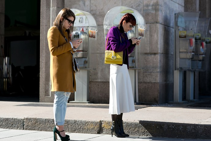 Women looking at phones