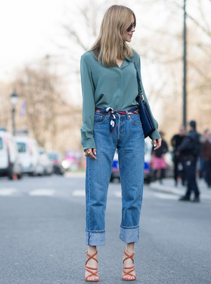 Belts are great and all, but try swapping in a beautiful silk scarf and knotting it to the side for change. It's a small tweak that'll make your basic jeans-and-top combo a little more French-lady polished.