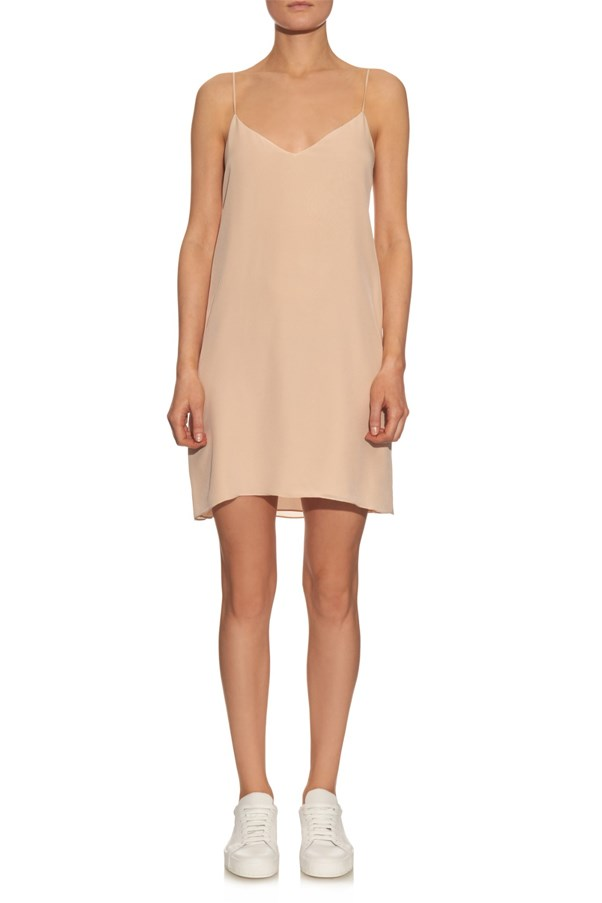 "<a href=""http://www.matchesfashion.com/au/products/Raey-Deep-V-silk-slip-dress-1060286"">Raey deep-v silk slip dress</a>, $273 AUD."