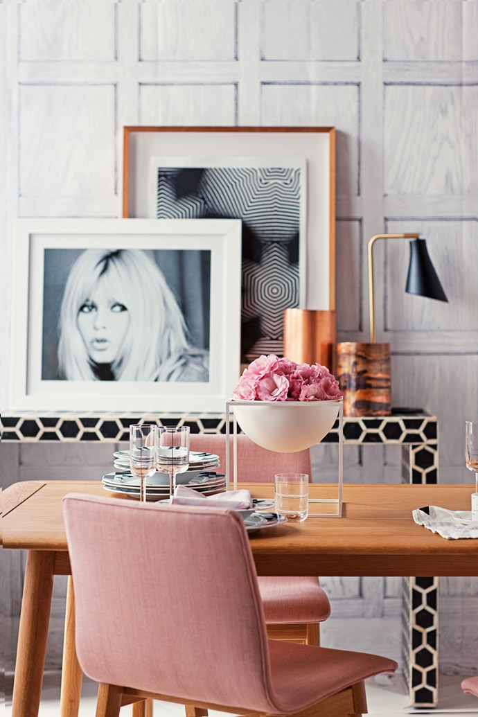 A chic, pastel-hued office space with poster of Brigitte Bardot.
