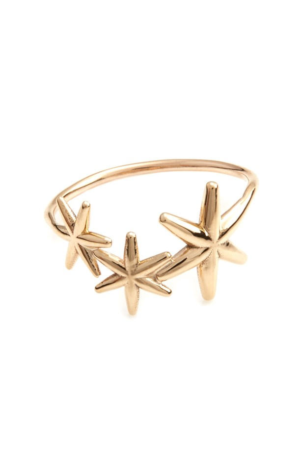 """<a href=""""https://www.sarahandsebastian.com/collections/rings/products/bold_star_ring_gold"""">Bold star ring, $460, Sarah & Sebastian at sarahandsebastian.com</a>"""