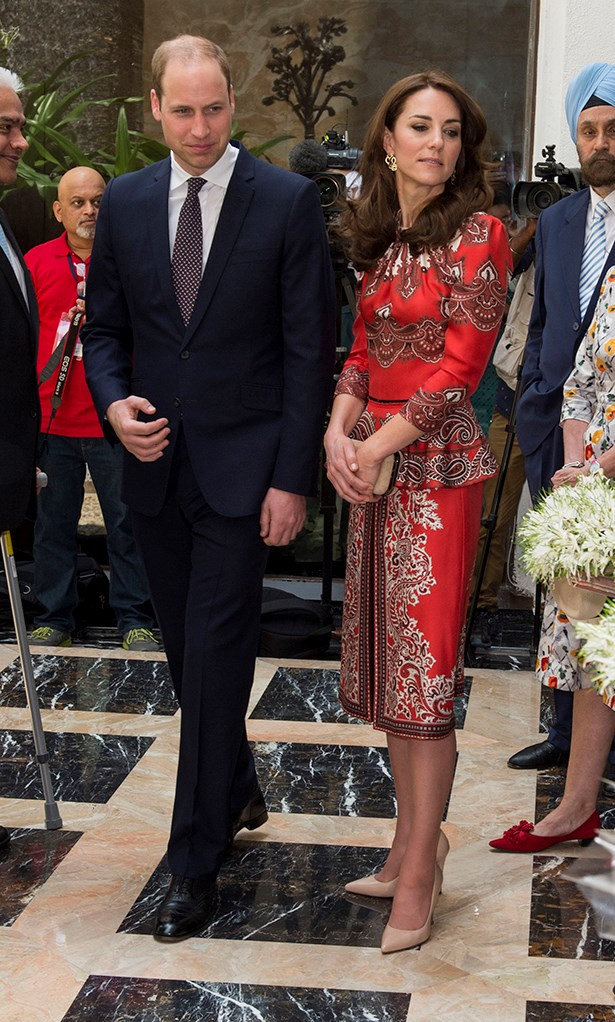 For the second day, Kate swapped blue for red in Alexander McQueen—her go-to designer (and the designer of her wedding dress).