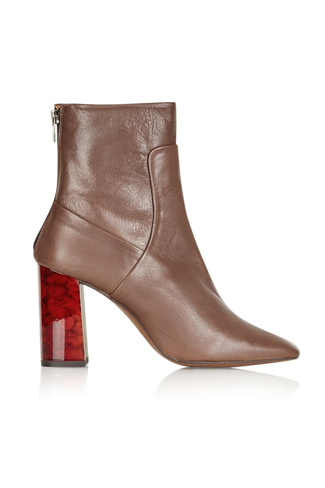 "<a href=""http://www.topshop.com/en/tsuk/product/shoes-430/heeled-boots-4967093/master-tortoise-heel-boots-4961446?bi=20&ps=20"">Boots, approx. $160, Topshop</a>"