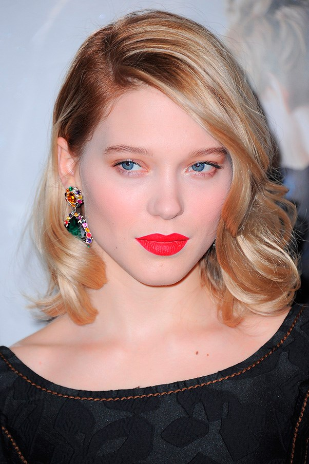 Lea Seydoux with red lipstick.