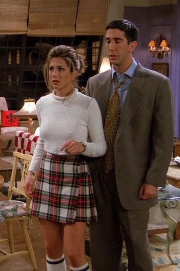 If we were transported back to the early '90s, you can be sure the first thing we'd do is purchase a cropped white turtleneck and a tartan pleated skirt.