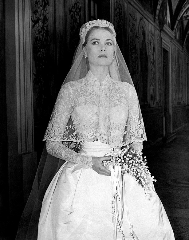 Grace's gown, made by costume designer Helen Rose, featured long lace sleeves, a high neck and a full skirt.