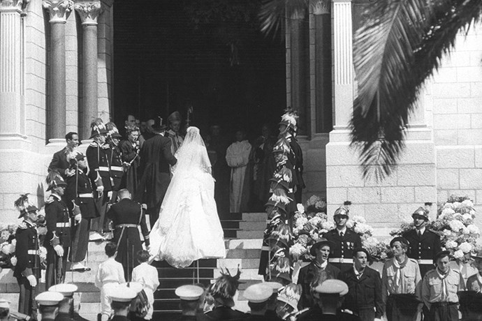 Grace enters the church with her father.
