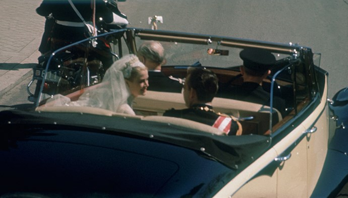 Grace and Rainier leave the church in a convertible car.