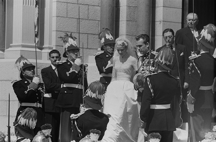 The new Princess Grace is saluted by guards.
