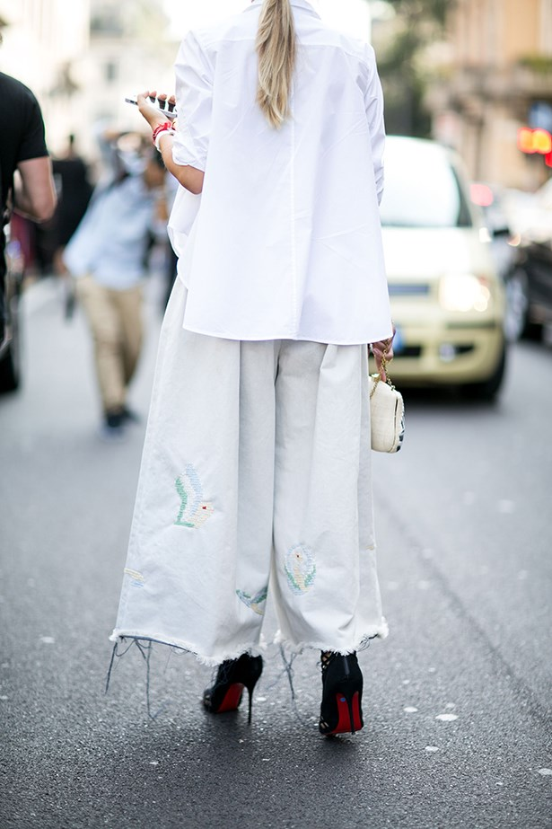 """Upgrade the classic white shirt with wide-legged trousers that crop just above your Louboutins."""