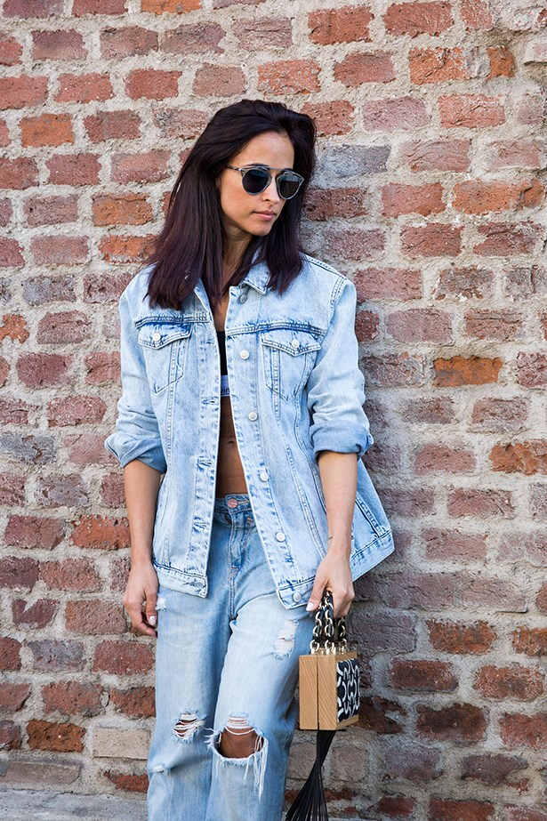 """This is how to do double denim right. Pale tones, perfectly worn patches and a mini bag to finish."""