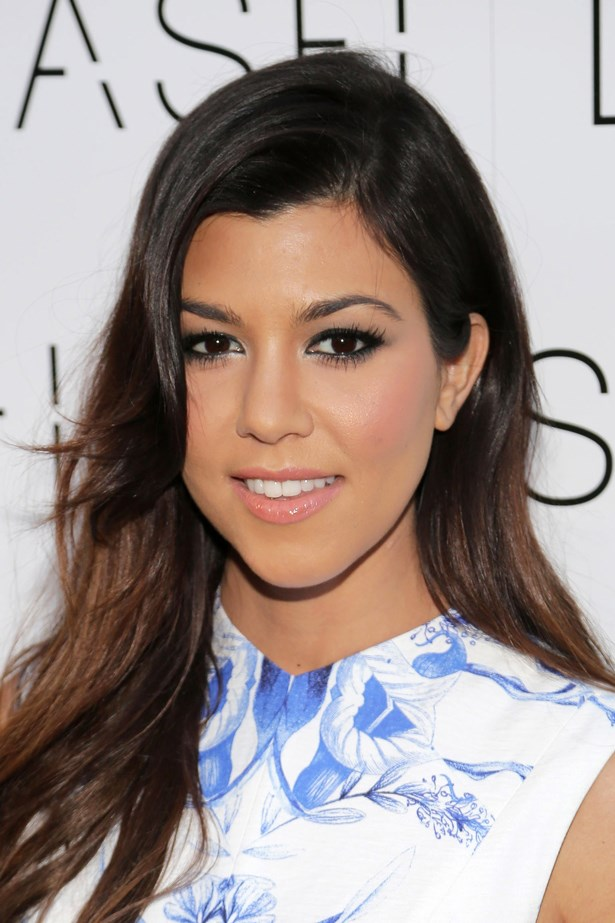 2014, Kourtney opts for kohl-rimmed eyes and a pretty peach pout at the Grand Opening of <em>DASH Miami.</em>