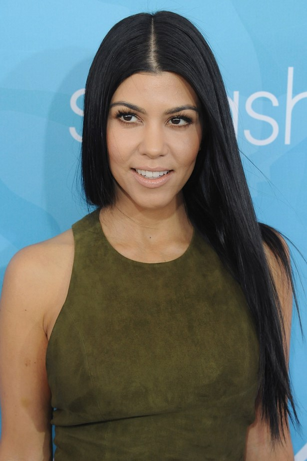 2015, Kourtney embraces a natural look with a nude lip at the <em>Women's Wear Daily and Variety Inaugural Stylemakers' Event</em>.
