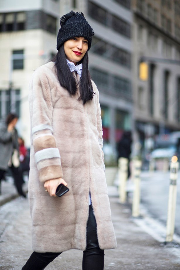 """A classic coat looks super-cool worn back with a pussybow blouse and beanie."""