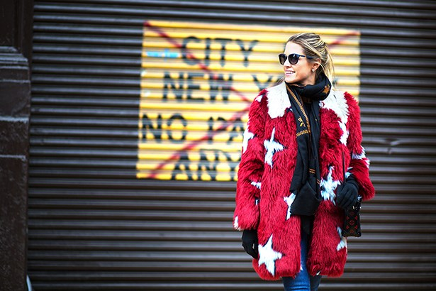 """Despite the chill factor, this girl looks like she's having a great time. The mix of textures and her star pattern in her coat is so fun — no wonder she's smiling."""
