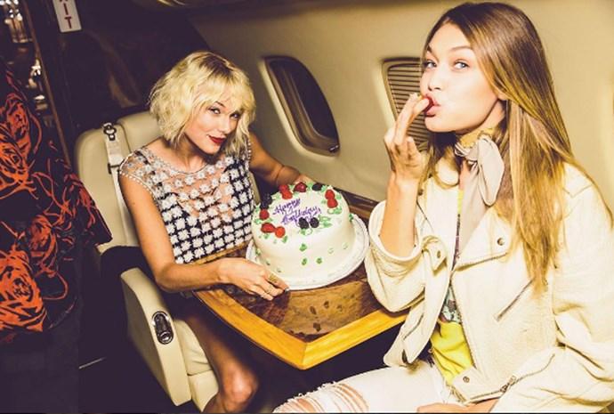 Gigi Hadid and Taylor Swift eating cake.