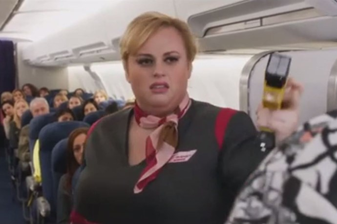 Rebel Wilson plays a flight attendant who tries to take Patsy down with a taser.