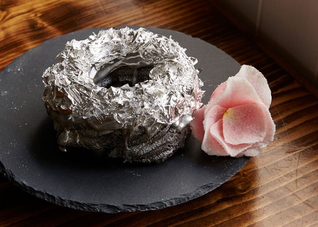 A Brooklyn chef has created a tequila-frosted donut topped with edible platinum and costing almost $200.