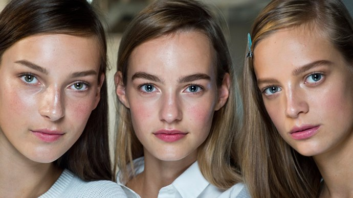 Models backstage at fashion week