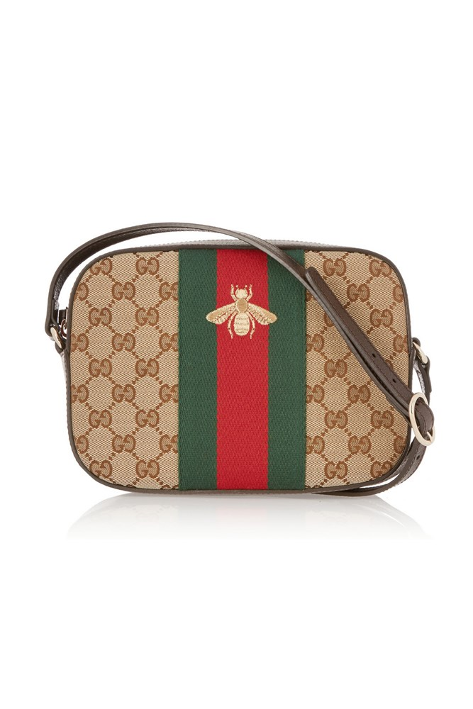 "<a href=""https://www.net-a-porter.com/au/en/product/643436/Gucci/linea-g-2-leather-trimmed-canvas-shoulder-bag"">Gucci Bag, </a>$1080."
